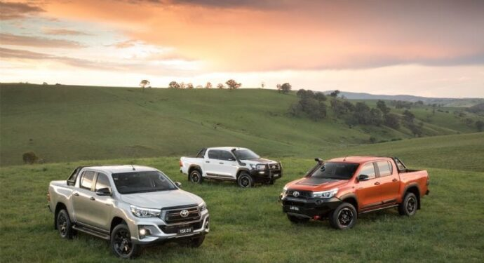 Toyota Hilux Utes in field